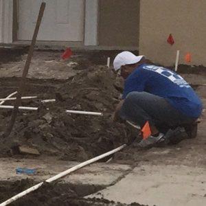 irrigation sprinkler technician at work installing a new sprinkler system